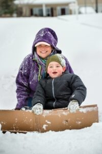 sledding mother and son