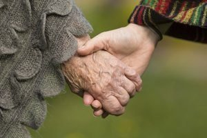 Holding hands together - old and young